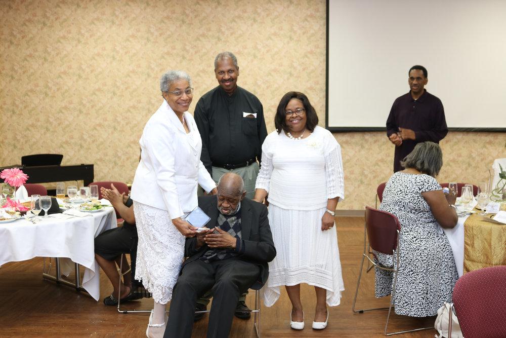 Roseland Lattier, Walter Williams, Edward E. Gooden (seated) and Shelia Dukes