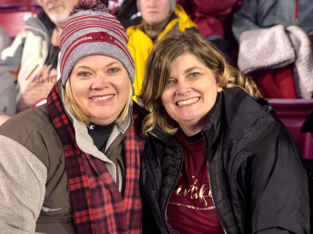 Sisters Terri Peace and Kim called the Hogs while attending an Arkansas Razorback football game on November 10.