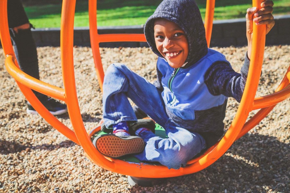 On a pretty fall day in October, Trinton enjoyed trying out the playground equipment at Spring Lake Park.