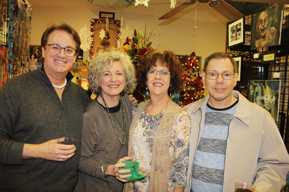Christopher, Judy Wright Walter, Glenna Bevill and Lavell Williamson during Christopher's Framing, Accessories, and Gallery's Christmas Open House this past November.