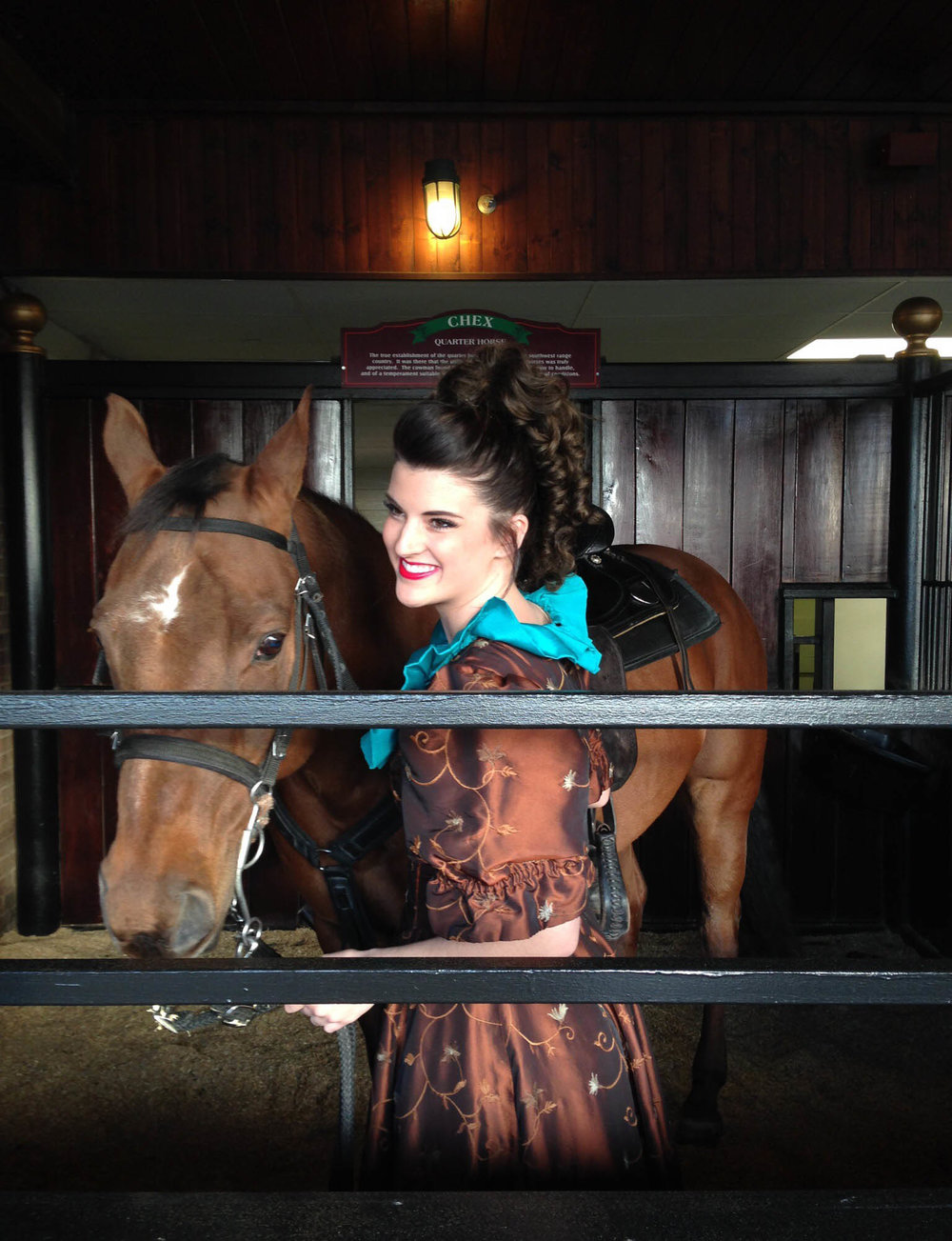 """On opening night of the Stampede in 2014, Taylor and """"Chex,"""" get ready for the show in his stall. He was her favorite horse until he retired this year, and she admits that he taught her so much."""