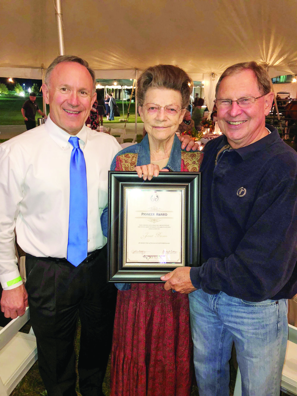 Former Texarkana mayors James Bramlett and Danny Gray present Janet with the Pioneer Award during the annual Alumni Association event last September.