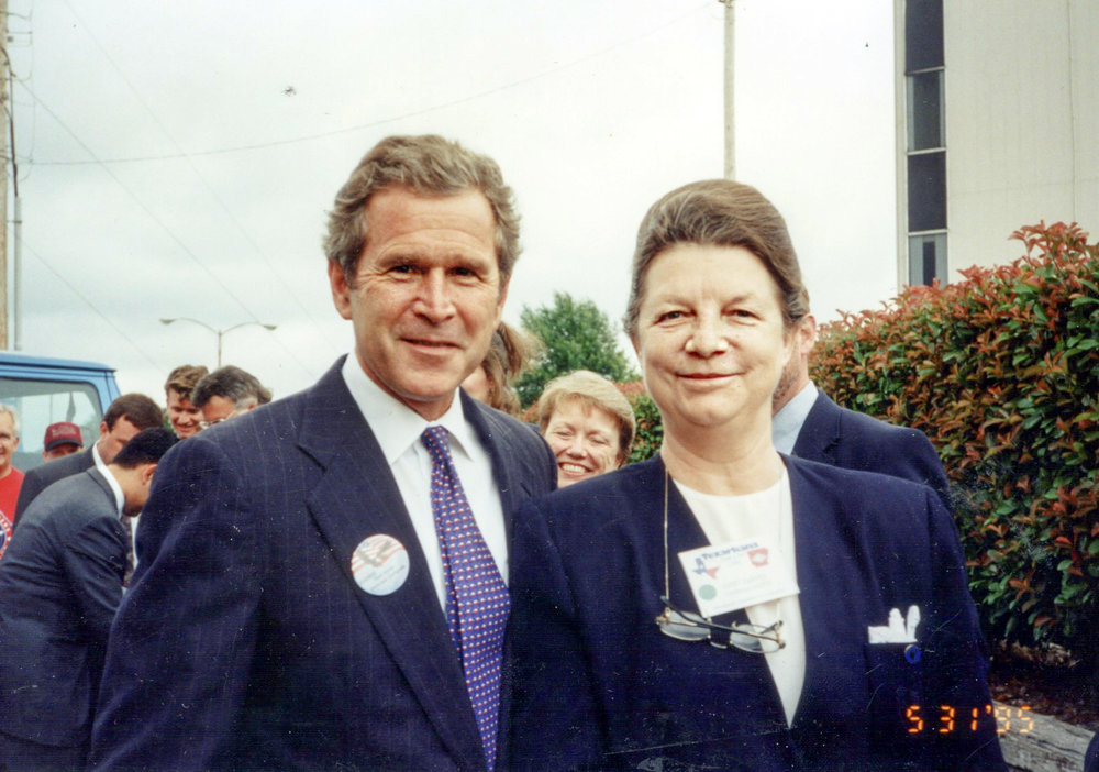 Former President George W. Bush visits with Janet in 1995 while he was campaigning to keep Red River Army Depot open.