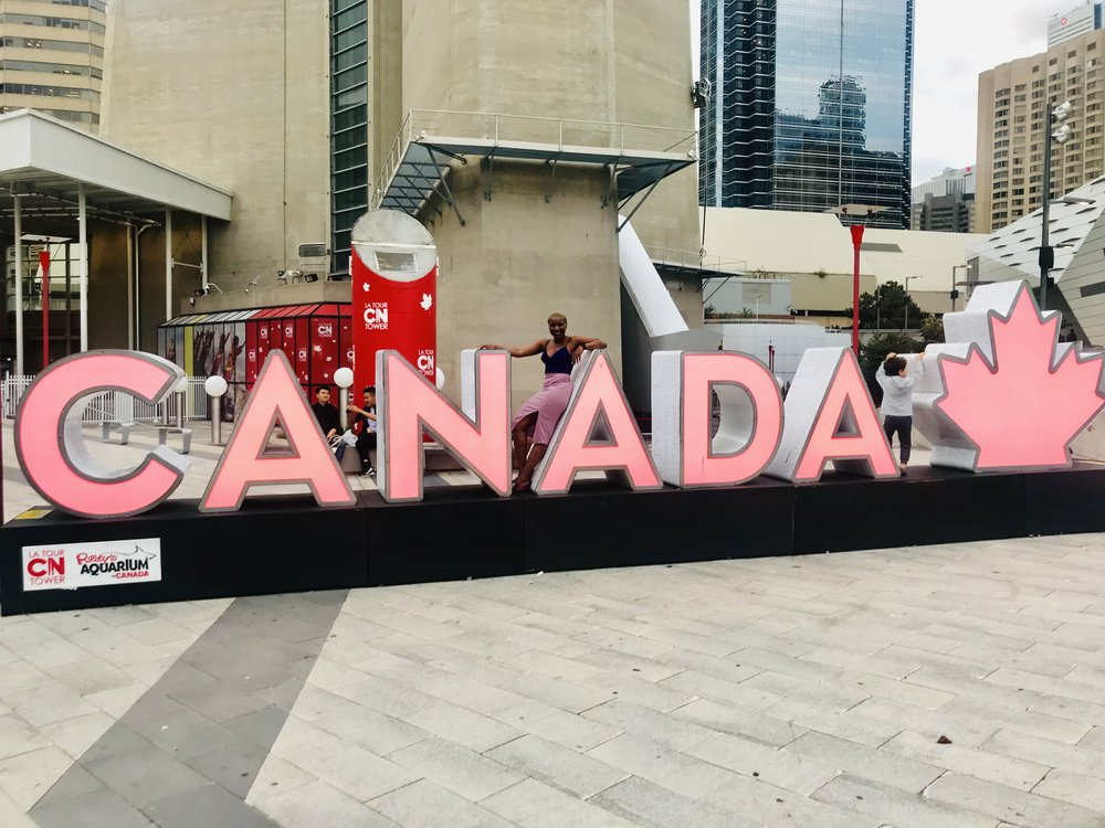 Forgot how to pose after waiting so long for my turn at the sign.  Toronto, Canada   Summer 2018