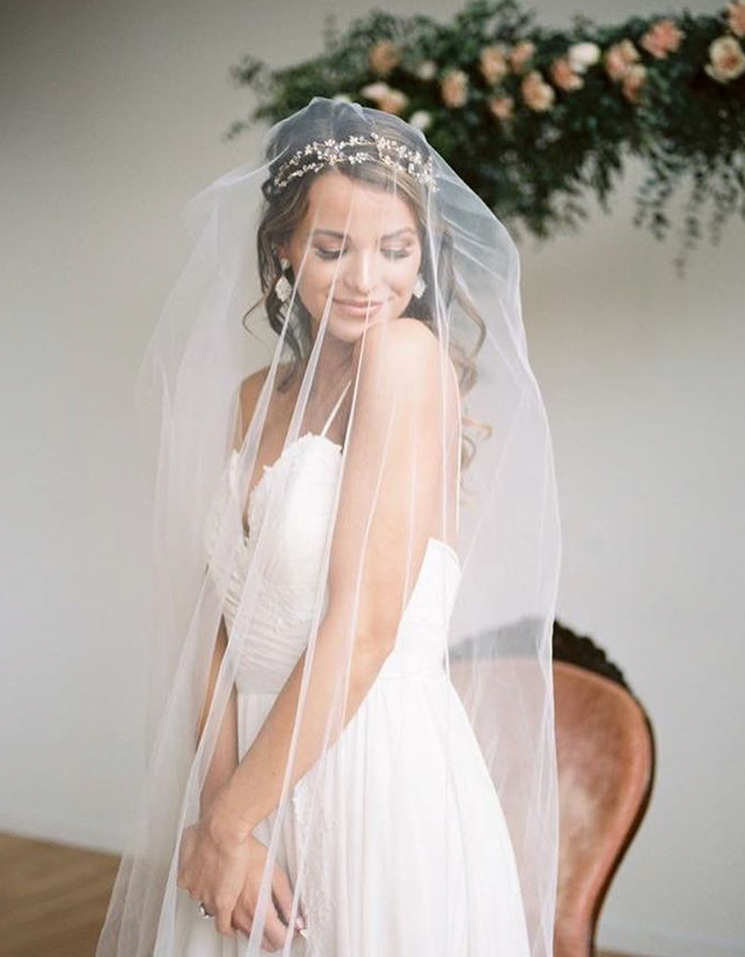 Wear a bridal hair vine as a headband with veil