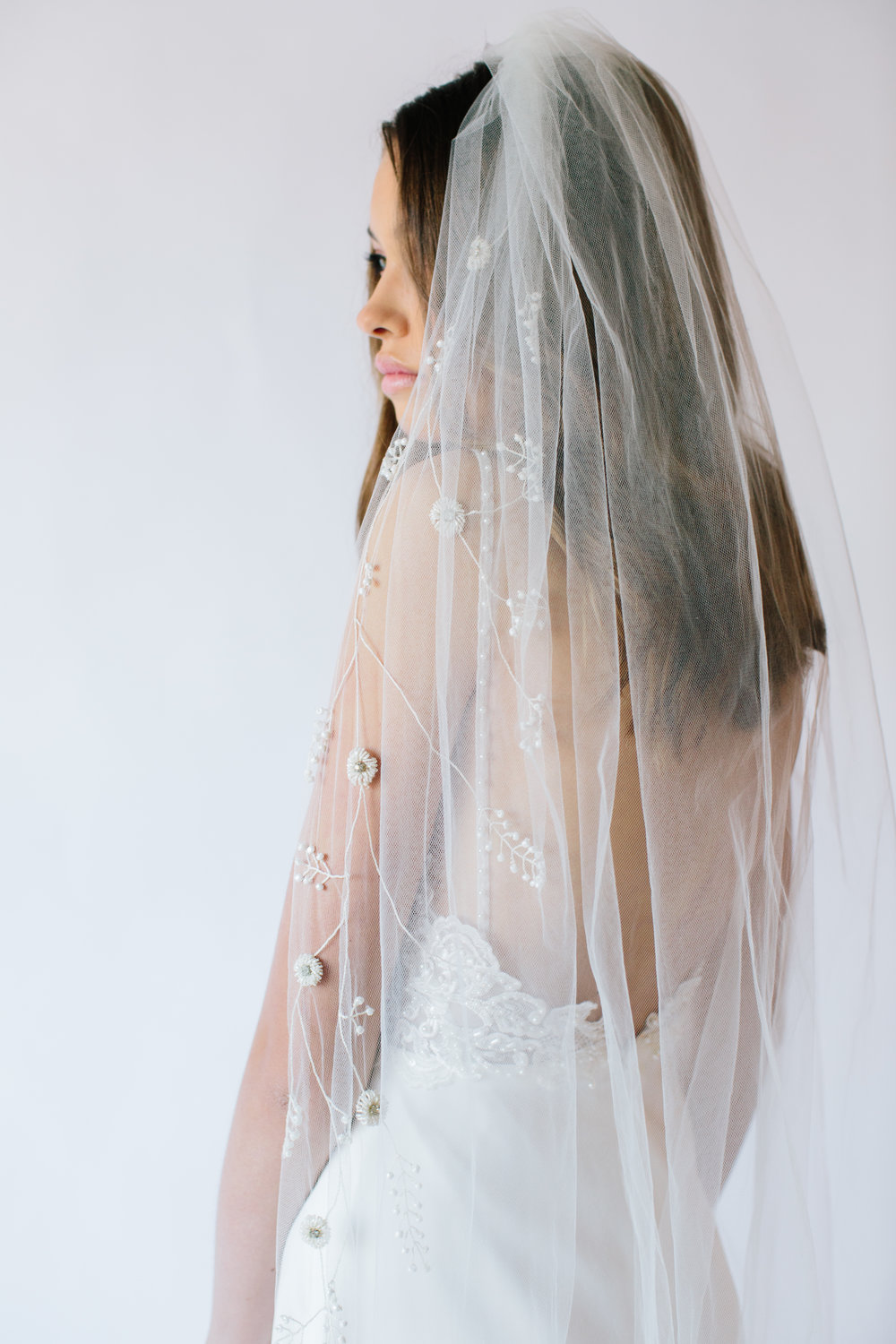 Ellis Veil   Details- One tier cathedral length veil with ivory hand beaded floral detailing  Full Beading - Cathedral $1,358  Half Beading (starting at Fingertips) - Cathedral $898