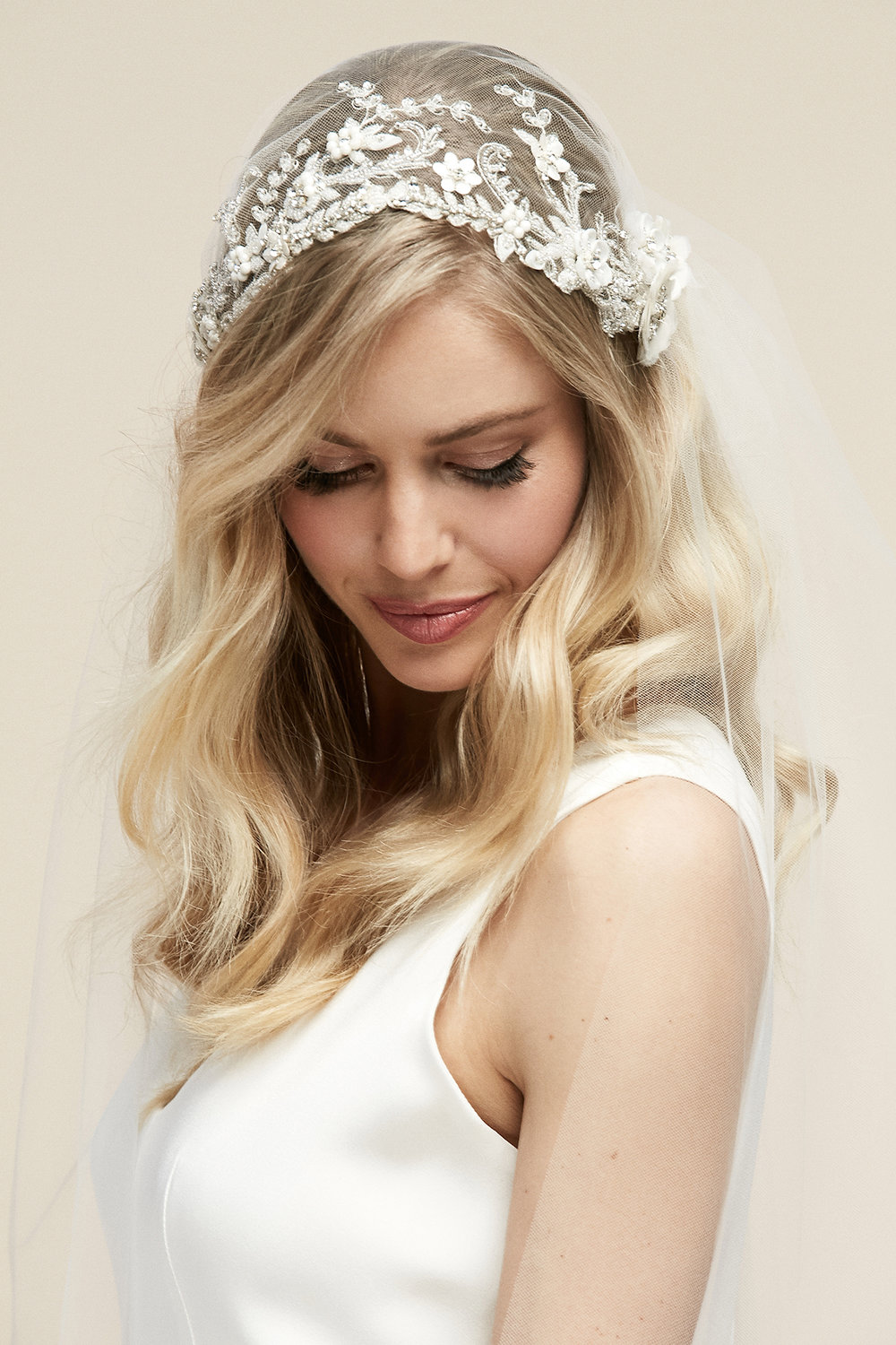 Sterling Cap Veil   Details- Hand beaded cap veil with fabric flowers  Available in Cathedral only
