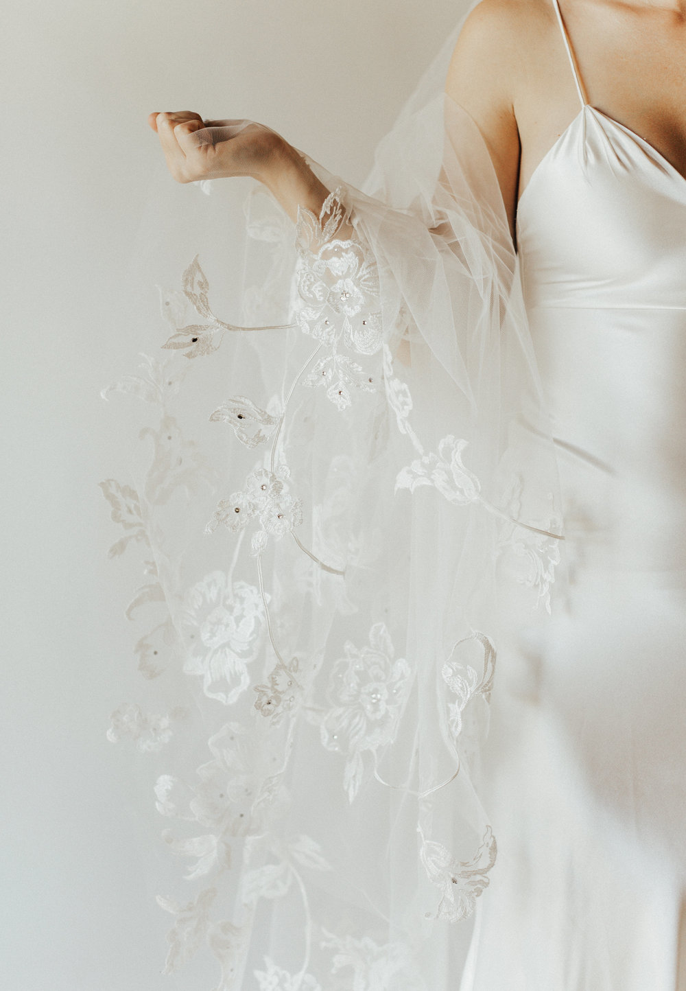 Ojai Veil   Details- Floral embroidery with a touch of sparkle  Available in Cathedral and ivory only