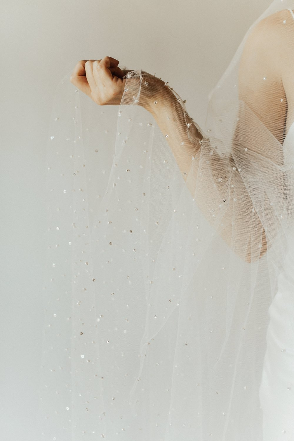 Avo Veil   Details- Hand beaded pearl and sequin veil  Available in Floor length only. Single Tier.