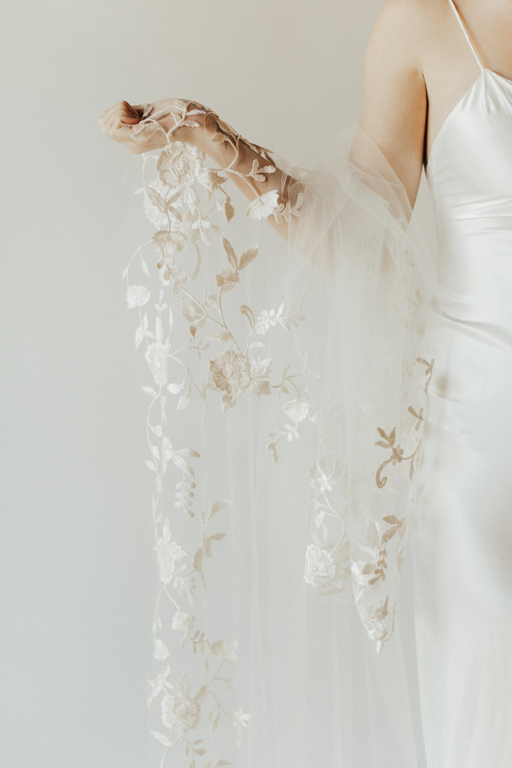Flora Veil   Details: One tier with hand embroidered lace detailing on edging  Cathedral Full Embroidery $1,138   Cathedral Half Embroidery $658