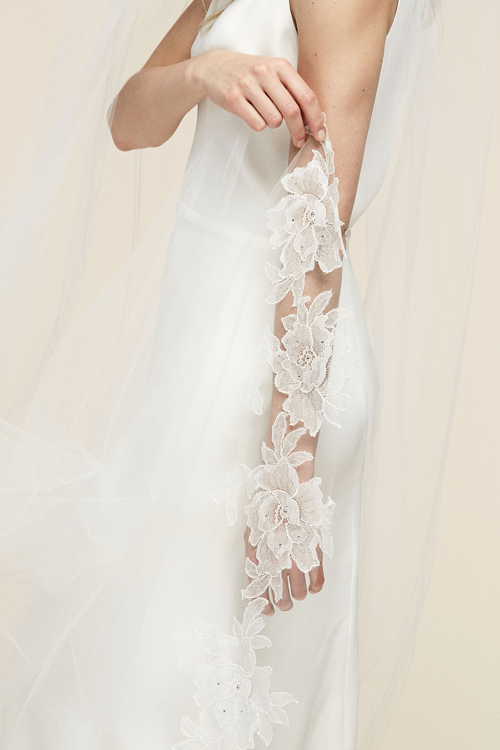 Jessa Veil   Details: Bottom edge of veil bordered with soft Chantilly lace accented by scattered crystals  Cathedral $1,358 - Fingertip $908 - Floor $1,188