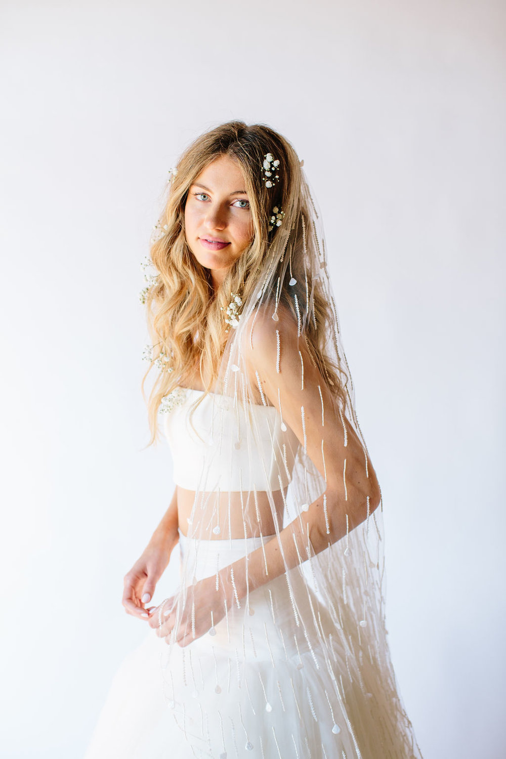 Shooting Star   Details: Once tier veil with gathered comb and all over white linear beading with shell detailing scattered throughout  Cathedral $838 - Fingertip $688