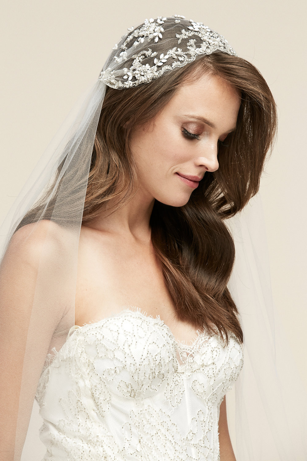 Topanga   Details: Hand beaded pearl and white stone floral Juliet cap veil  Cathedral only $594