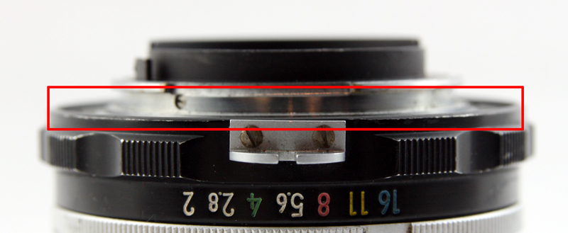 The smooth face of a Nikon non-AI mount is its distinguishing feature. The metal flange used for meter coupling can also be seen in the center of the image.