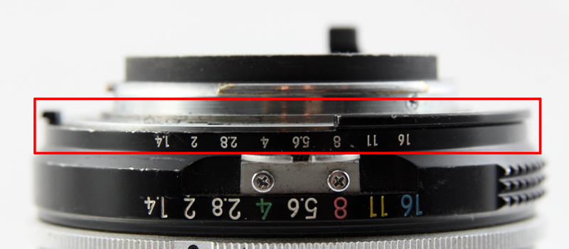 Notches cut into the mount of an AI Nikon lens allow it to couple to the meter in the camera.