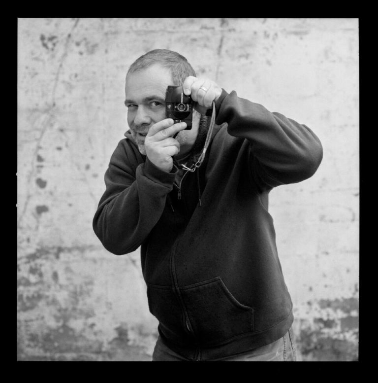 Ian Beckett - Where you'll see him: You probably won't! Ian comes in after-hours to develop our black and white film in the darkroom.  He is the chemical wizard behind our recovery C-41 and B&W lines, as well as our C-22 and ECN-2 processing.What he does in his off time: Ian spends time with his wife and daughter and, of course, makes photos. Ian also runs Beckett Lead, where he preserves the historical craft of lead typesetting for letterpress printing and ceramic impressions.What he listens to in the darkroom: Blazer games, Meat PuppetsWhat's in his camera bag: Olympus XA2, Mamiya C330, Speed GraphicBeckett Lead