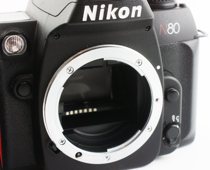 Some Nikon bodies lack the coupling lever, making them safe to mount both Non-AI and AI lenses. However, this is often done at the sacrifice of metering.