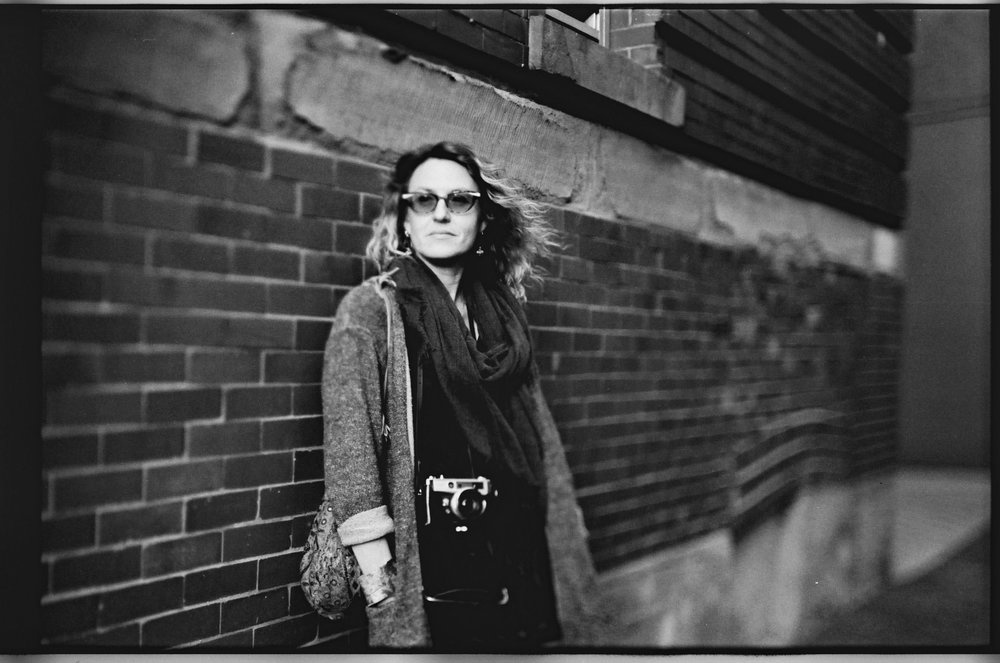 Joanne with her rangefinder camera . Freelensing version. Film Washi D 500 Sputnik Panchromatic black and white film. ©2018 Mark Klotz