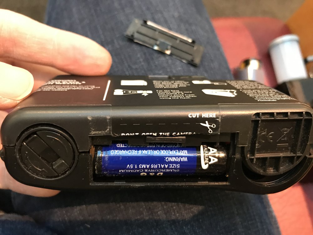 These cameras have a built in flash, and the battery can easily be replaced. It takes a AA size battery.