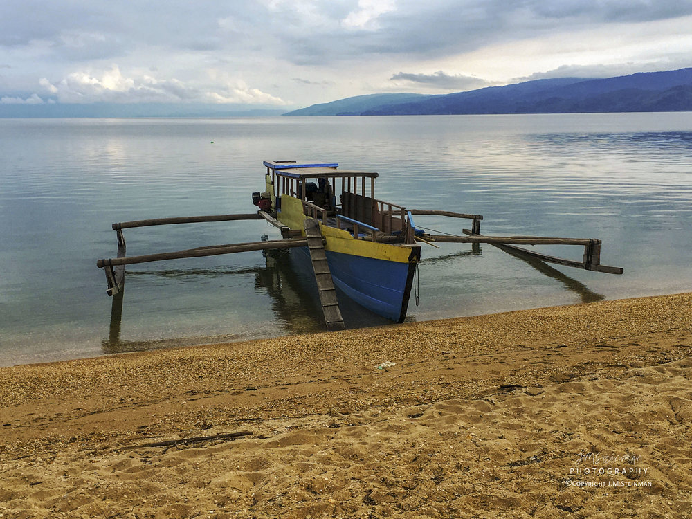 Beautiful Lake Poso where this little outrigger carried us across the 18km lake in three hours to Tentena