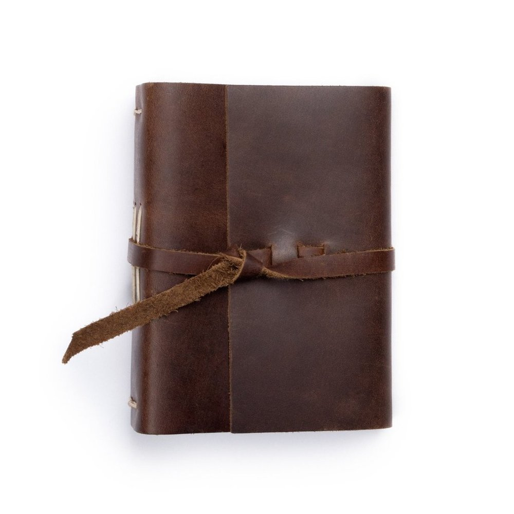 CUSTOM ALBUM - $120Handmade leather photo album with two lines of personalized text stamped on the cover. Measures 5