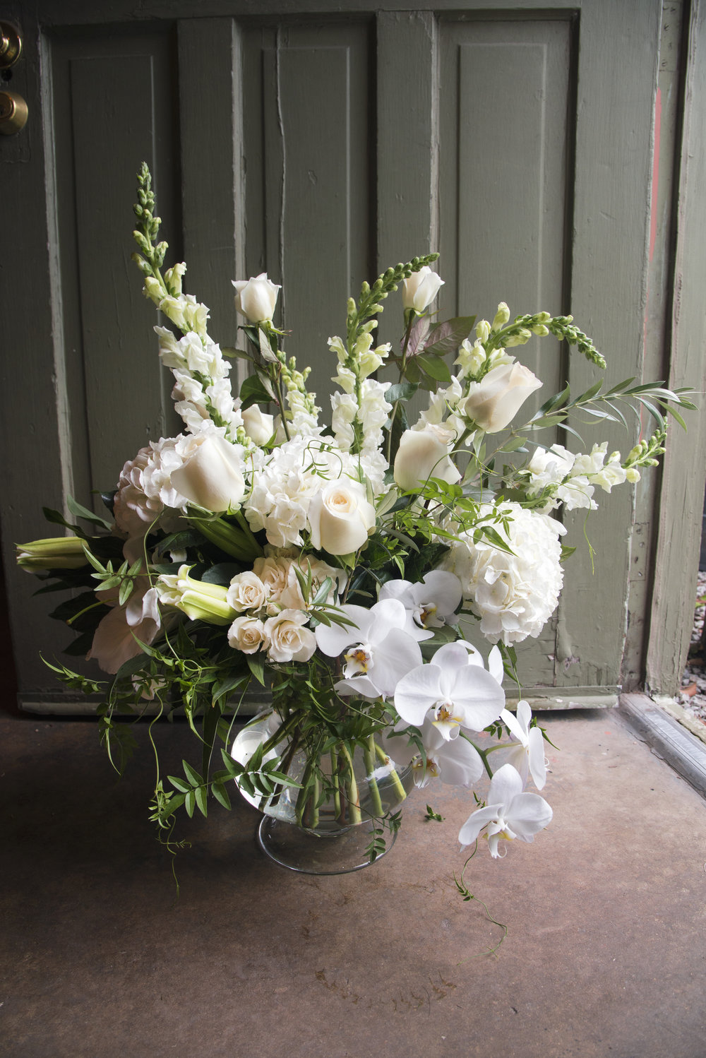 big white arrangement that was destoryed shortly after this photograph was taken mitchs flowers fresh cut arranegments and pizza (1).jpg