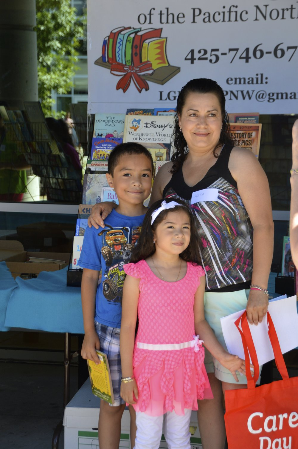 Beautiful Latino family with books and Care Day bag.jpg