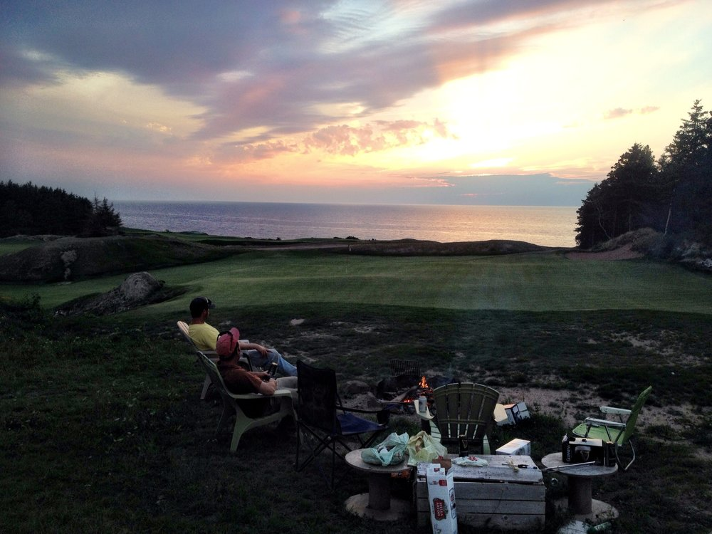 The after-work fire pit located above the 14th green at Cabot Cliffs