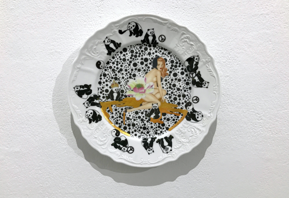 "All You Can Buy (1/15), 2016, ready-made porcelain Plate, ceramic decal, gold leaf, lacquer 11""x11"""