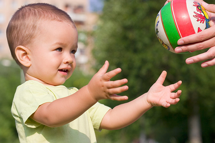 toddler throwing 2 passing catching.jpg
