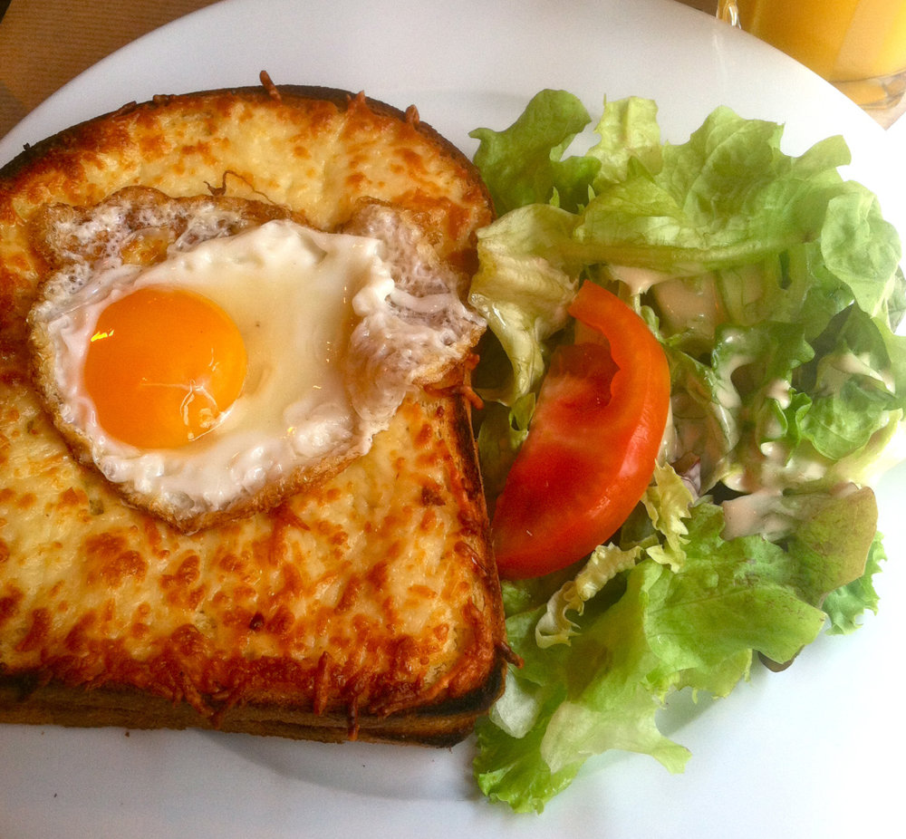 Throughout the entire trip, I was determined have a croque madame. The sandwich is one of my favorite meals back in America so I knew that I had to try one in France for a comparison! The croque madame is a simple sandwich, with creamy béchamel, ham and gruyere cheese usually served open-faced on a baguette and broiled in an oven until the cheese bubbles up and crisps. The Final touch is a fried egg thrown on top. I like to dig in with a fork and knife and make the perfect bite of doughy bread with salty ham and gobs of stringy melted cheese soaked up in runny egg yolk. The restaurant we chose to eat in was a small café at the base of the Eifel tower. While the sandwich was good, I have to admit that the dry toast and flavorless filling was woefully disappointing.