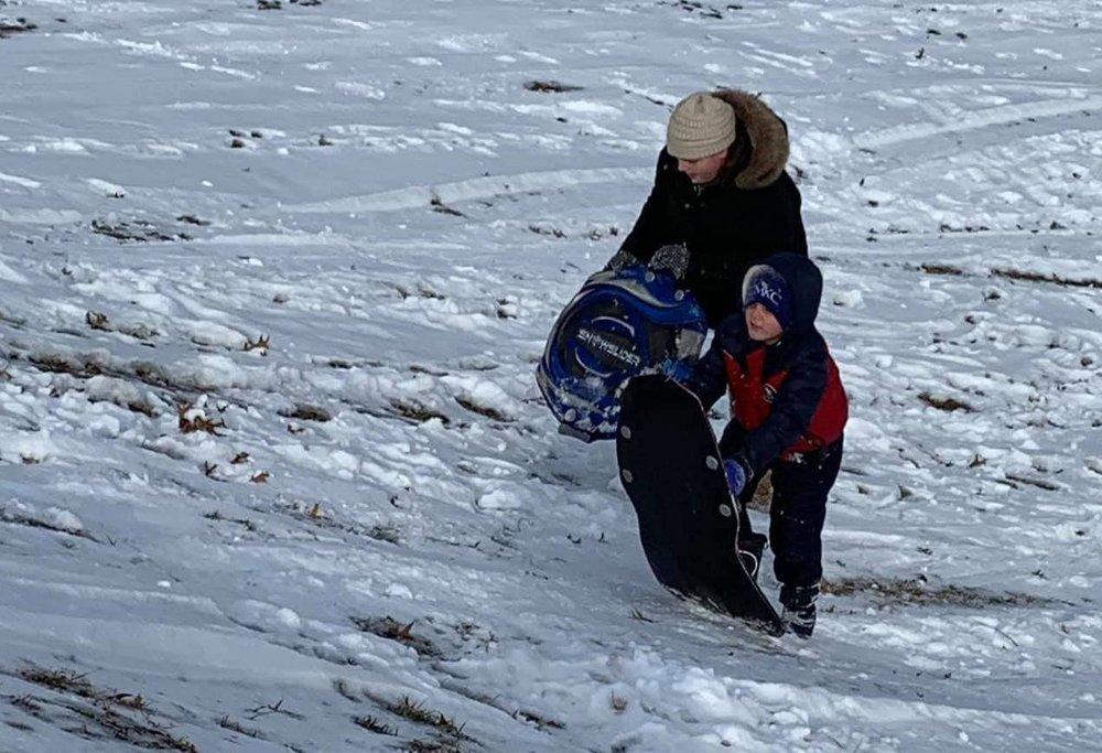 Addie & Braxton climbing a big, long hill after sledding down. What fun!!