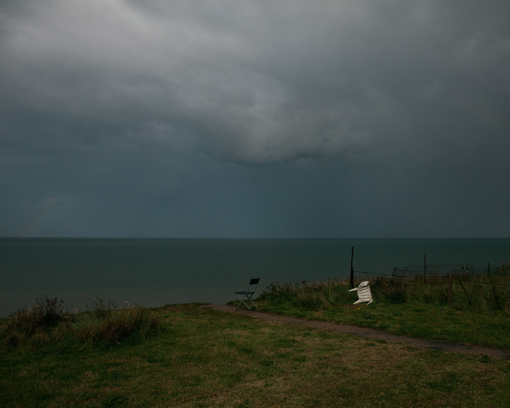 A storm brews in Bryony's back garden, half of which has been lost to the sea.
