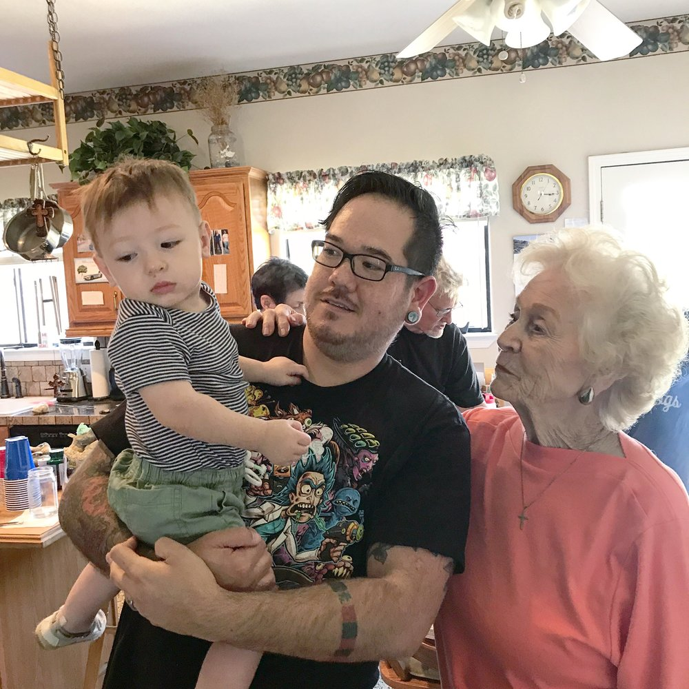 Great-Grandma meeting the littlest turd for the first time.