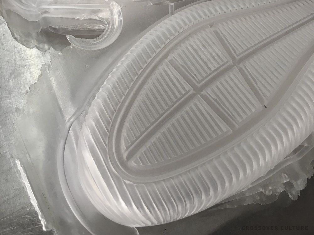 newly pressed rubber outsole waiting to be trimmed