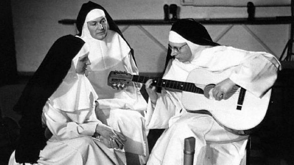 nun-with-guitar.jpg