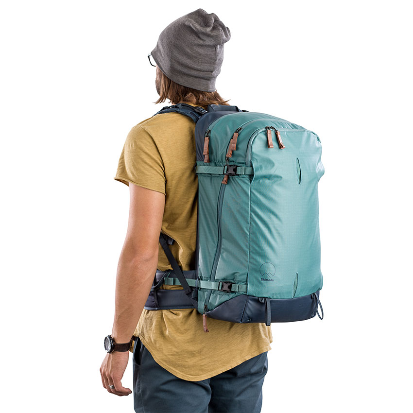 Features - • Height-Adjustable Harness• Side and rear access.• Instant access to phones, radios, water, food and other essentials• Multi-Configurable Front Panel• Convertible, multi-use tripod pouch• Extremely weather-resistant, resin-coated nylon shell• Waterproof Splashguard™ YKK® zippers