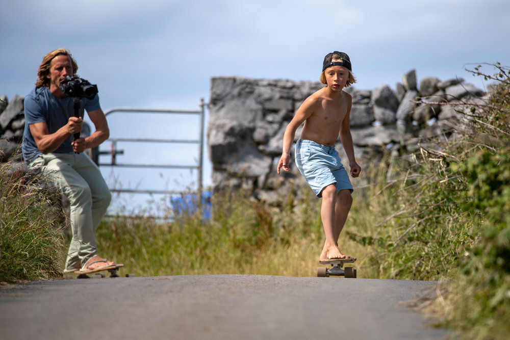 George filming Joshua skateboarding.