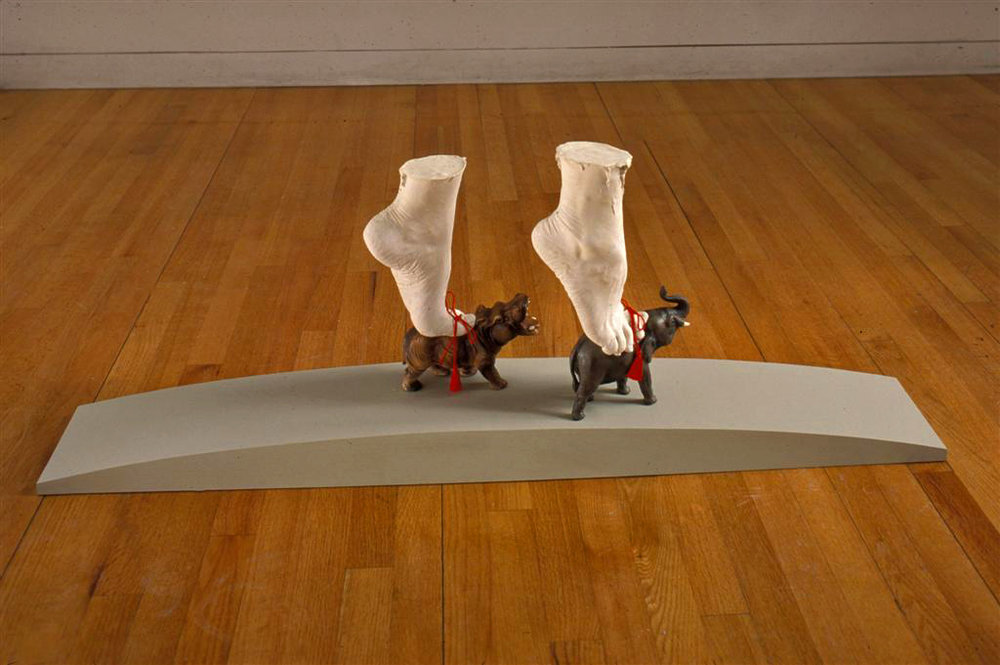 GETA (2003) / Cast feet, mixed media, 15 x 38 x 10""