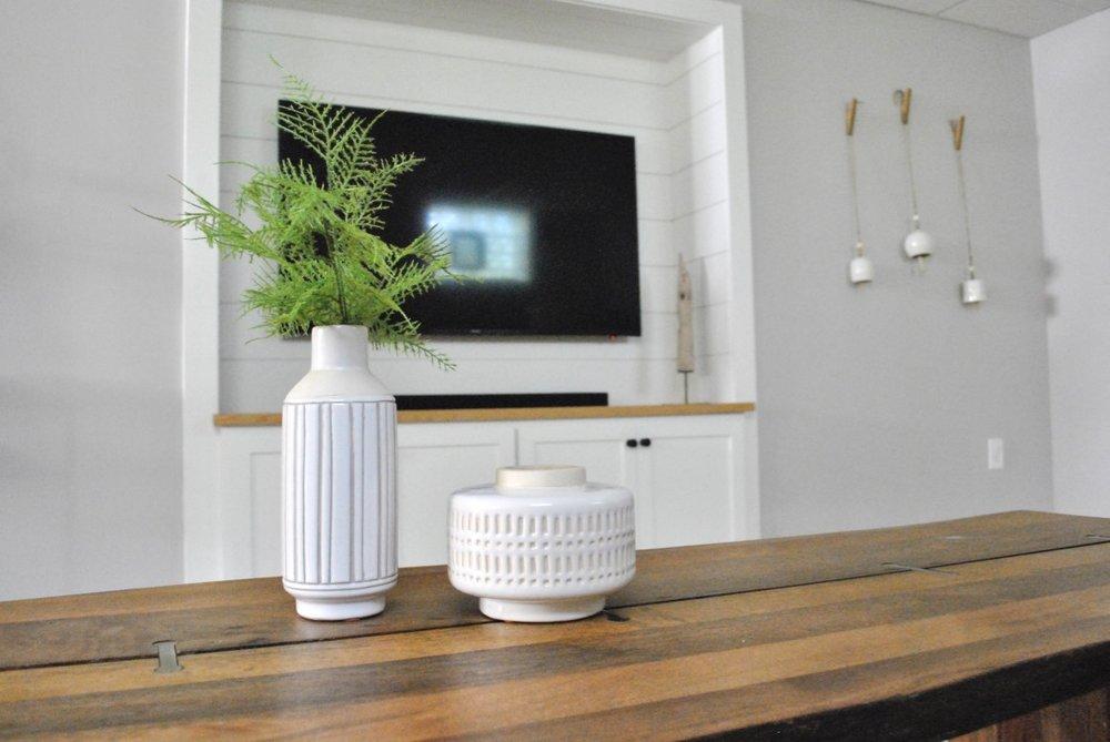 Basement design built-in media cabinet with shiplap.