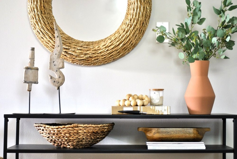 Console table with organic and wood accessories.