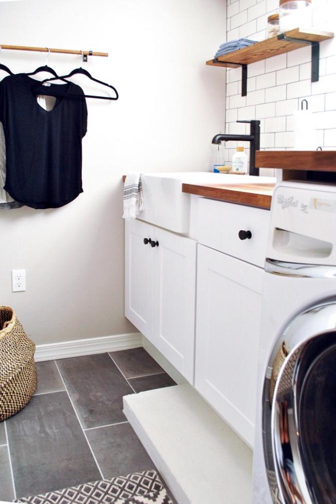 Farmhouse laundry room with subway tile, and gray ceramic tile floors | Sharp + Grey Interiors