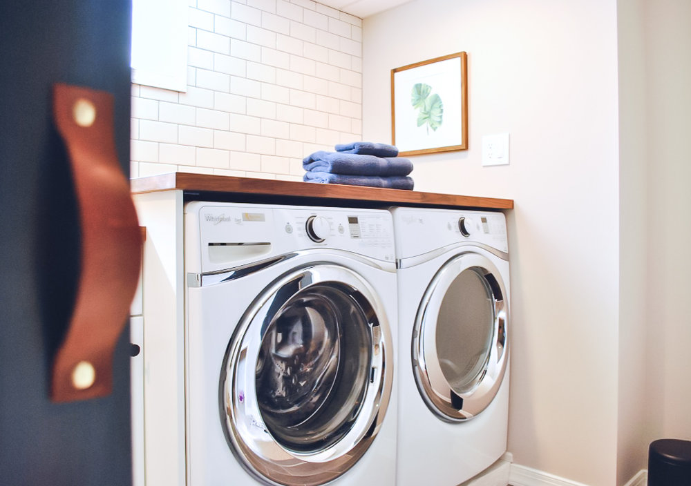 Laundry room with leather handles on sliding doors | Sharp + Grey Interiors