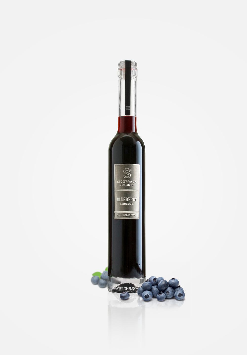 Blueberry Liqueur - This liqueur infuses the sweet subtle taste of our own grown all natural berries with a touch of lemon to bring out the full flavor. Sweet but not too sweet, this fruit forward liqueur is a natural digestif or can be used to create unique cocktails and delicious desserts.