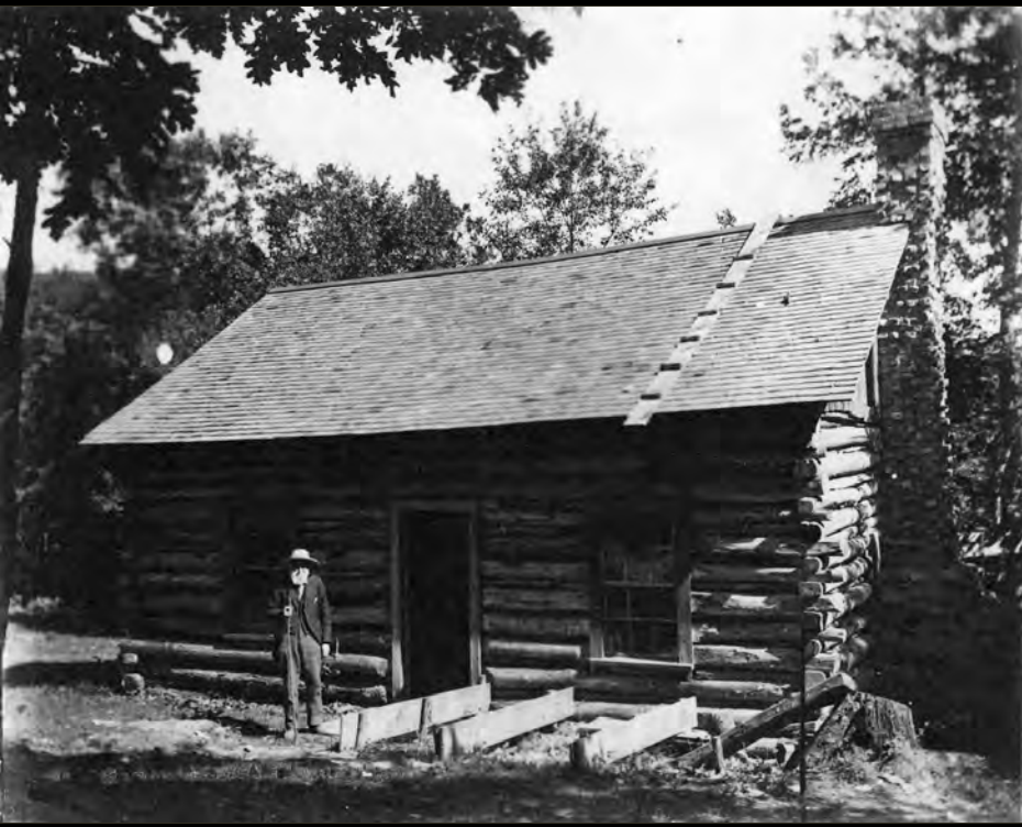 Mr. Canfield can be seen standing in front of the cabin in the photo at the right.