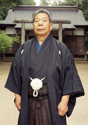 Morihiro Saito Shihan, O-Sensei's chosen successor of the Iwama dojo standing in front of the Aiki Shrine