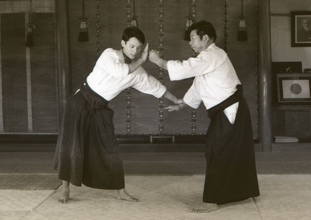 A young Jason blocks an atemi from Saito Sensei at the Iwama dojo.  This photo was part of a technical series for the Aikido Journal magazine.