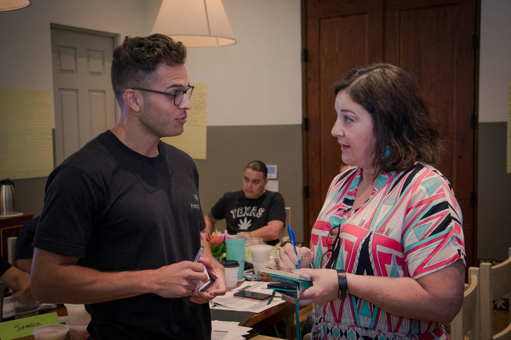 Iris Gonzalez interviews a person for quotes to add to a developing story. Courtesy Marcus Macias Photos..jpg