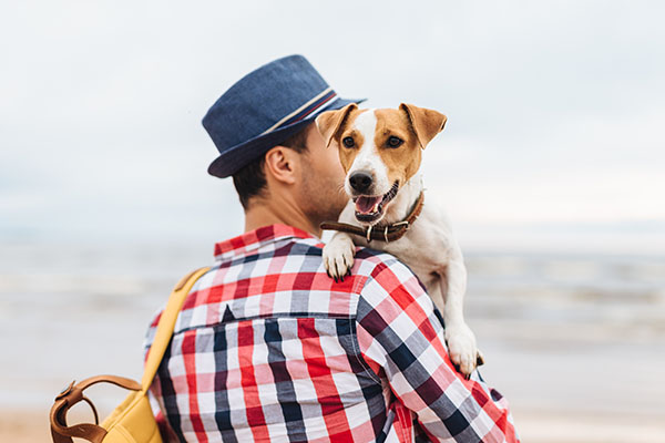 bigstock_man_with_dog_crop 600 223254076.jpg