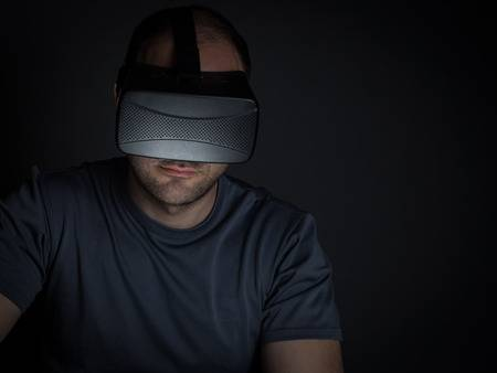 65044028-technology-addicted-man-at-home-at-night-using-virtual-reality-headset-technology-addiction-concept-.jpg